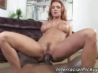 older  brunette with super  tits drives ebony