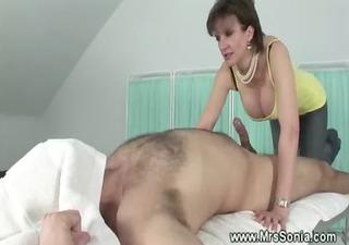 dominatrix teasing a dong