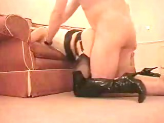lady in leather fucked from behind.