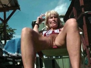 bushy older  smoker flashes her kitty and anal