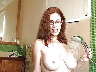 naughty rufous milf with glasses gets sperm on