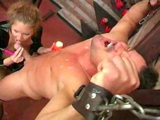 grown-up dominatrix uses her slave