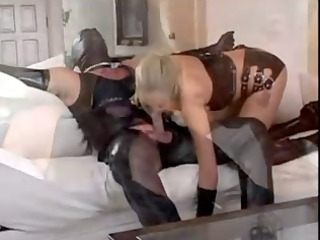 babe stretched luvs her guy in rubber