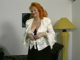 redheaded german elderly shows off for the camera