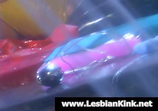 two lesbians in latex toying slick cunts