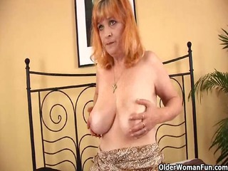redheaded old with large tits sucks strapon and